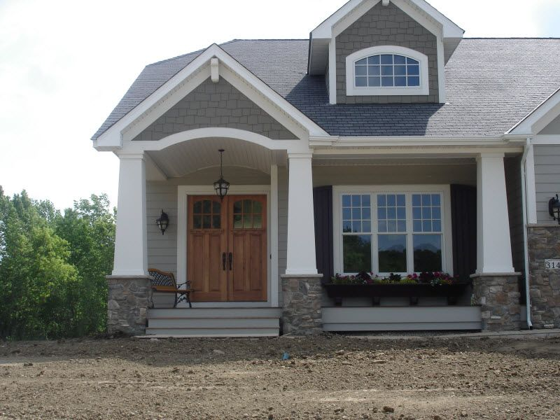 Exterior columns craftsman style home with front porch for Columns for house exterior