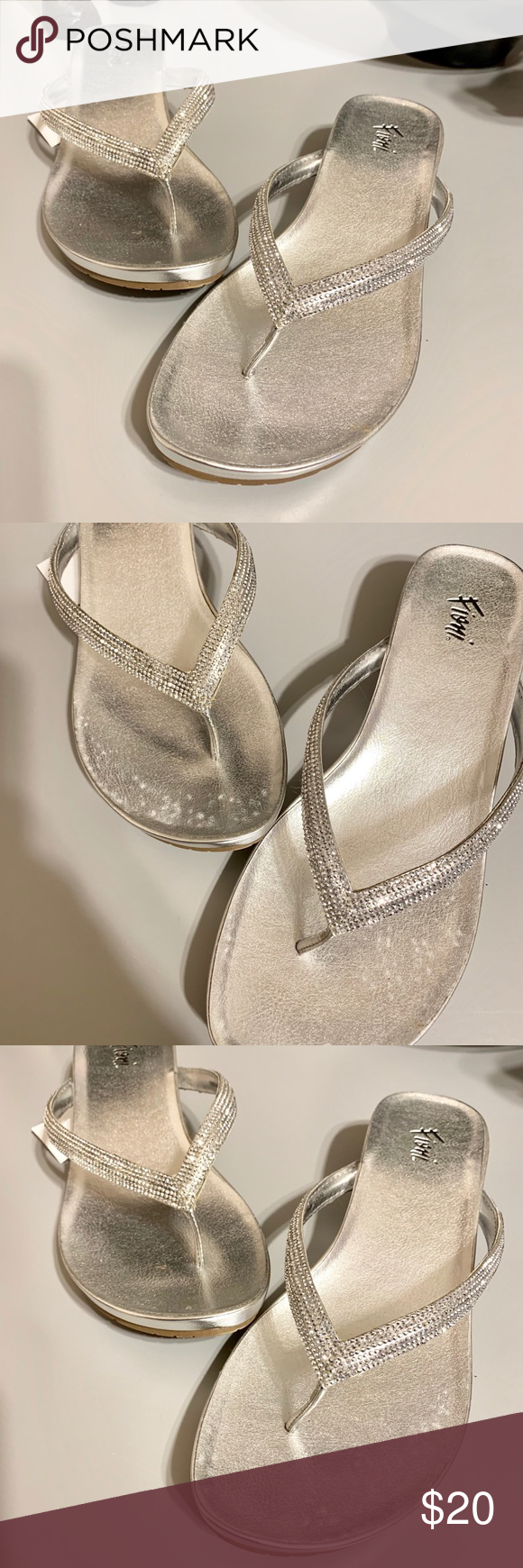 Fioni Silver Blingy Low Wedge Sandals This is a brand new with tags pair of Blingy silver sandals with a low wedge in a size 9 1/2. The design of the shoe creates a slight rocking motion as you walk. It has clear stones covering the top. Fioni Shoes Sandals #lowwedgesandals Fioni Silver Blingy Low Wedge Sandals This is a brand new with tags pair of Blingy silver sandals with a low wedge in a size 9 1/2. The design of the shoe creates a slight rocking motion as you walk. It has clear stones cover #lowwedgesandals