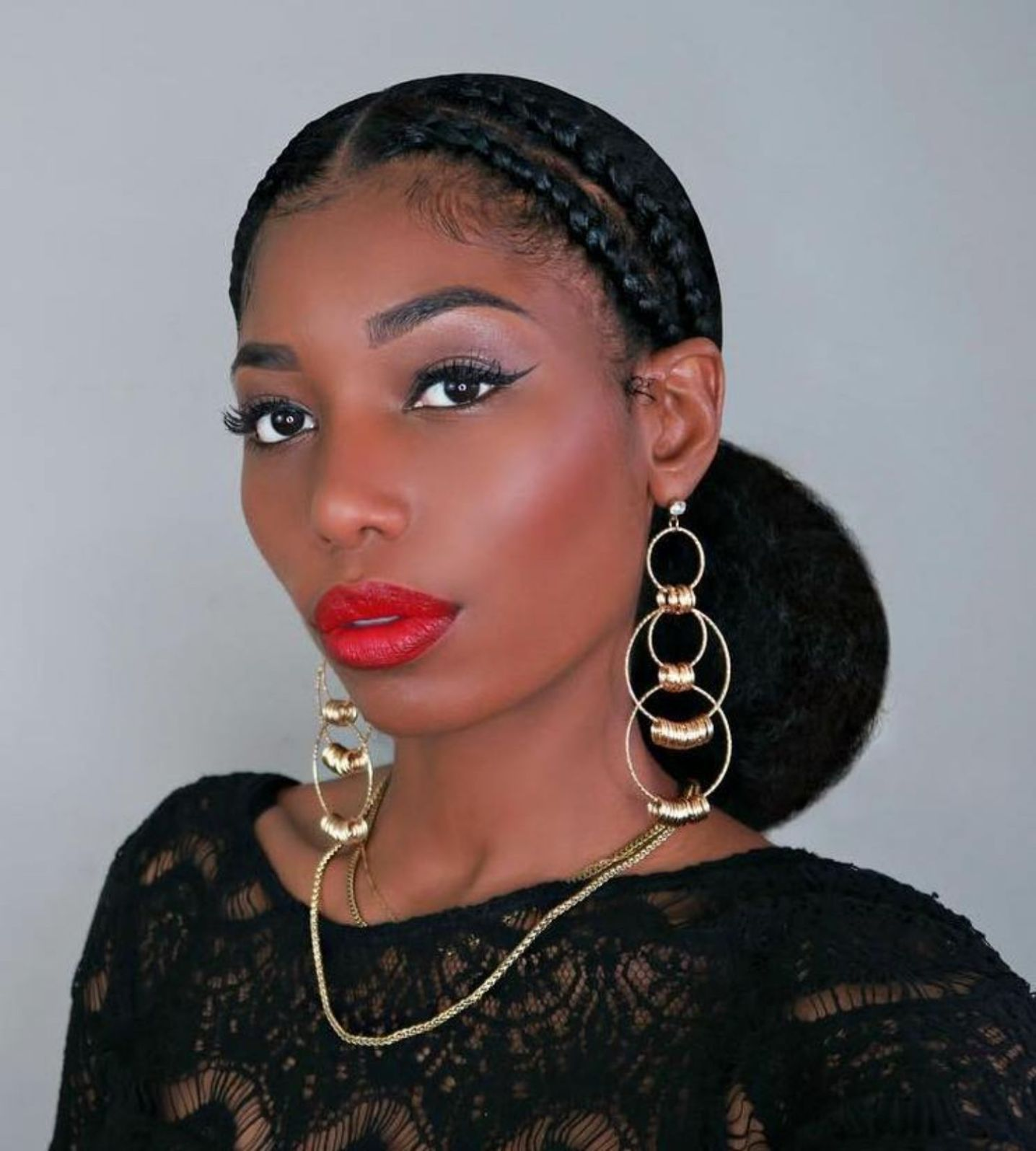 Cornrow Updo With A Big Low Bun Protective Hairstyles For Natural Hair Natural Hair Bun Styles Natural Hair Styles