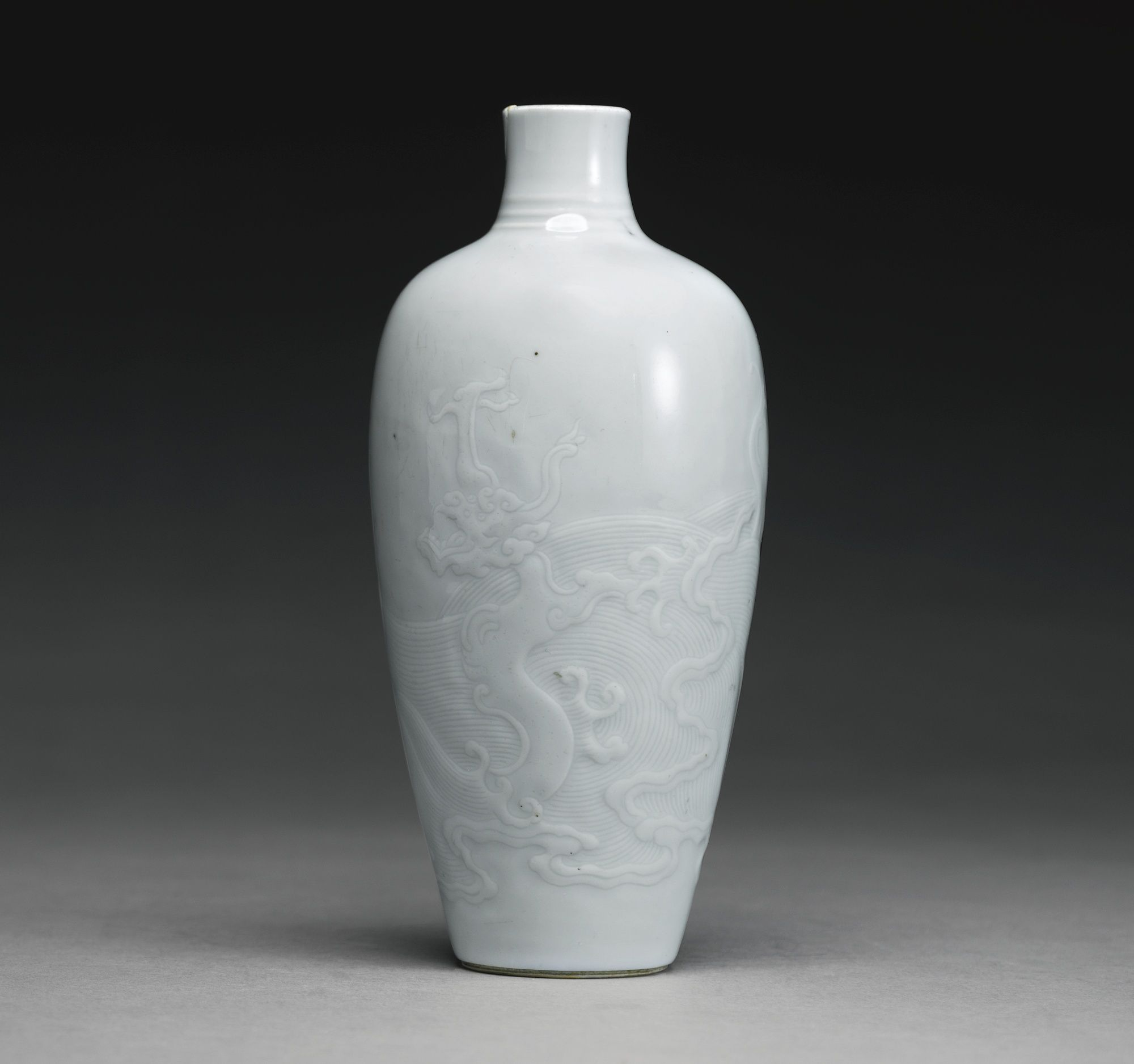 Image result for A rare white-glazed 'Dragon' vase, Qing dynasty, Kangxi period