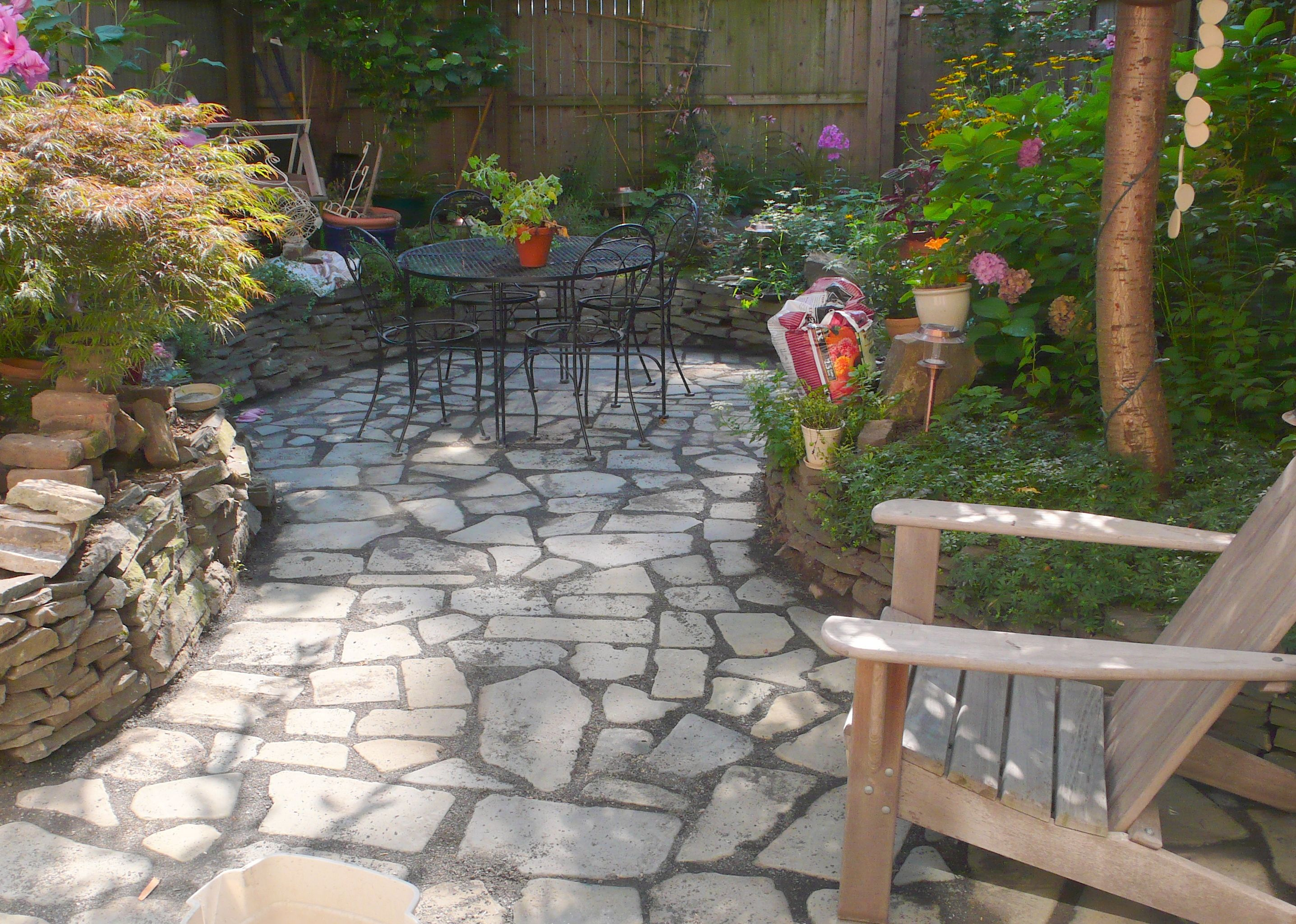 sunken patio backing to a french drain grading project