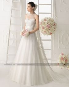 one shoulder Soft tulle and lace wedding dress with beading and flower in a natural colour
