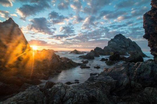 Bermagui Camel Rock at Sunrise Light Rays Australia