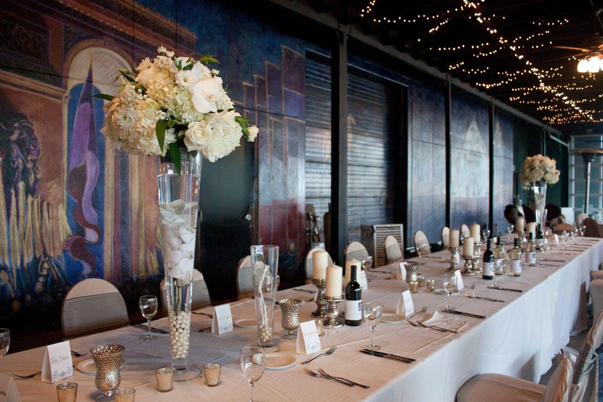 Lovely white wedding reception decor in the Chateau Elan Winery Pavillion
