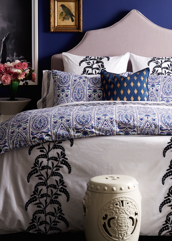 Love How The Blue And White Patterned Bedding Looks Against The