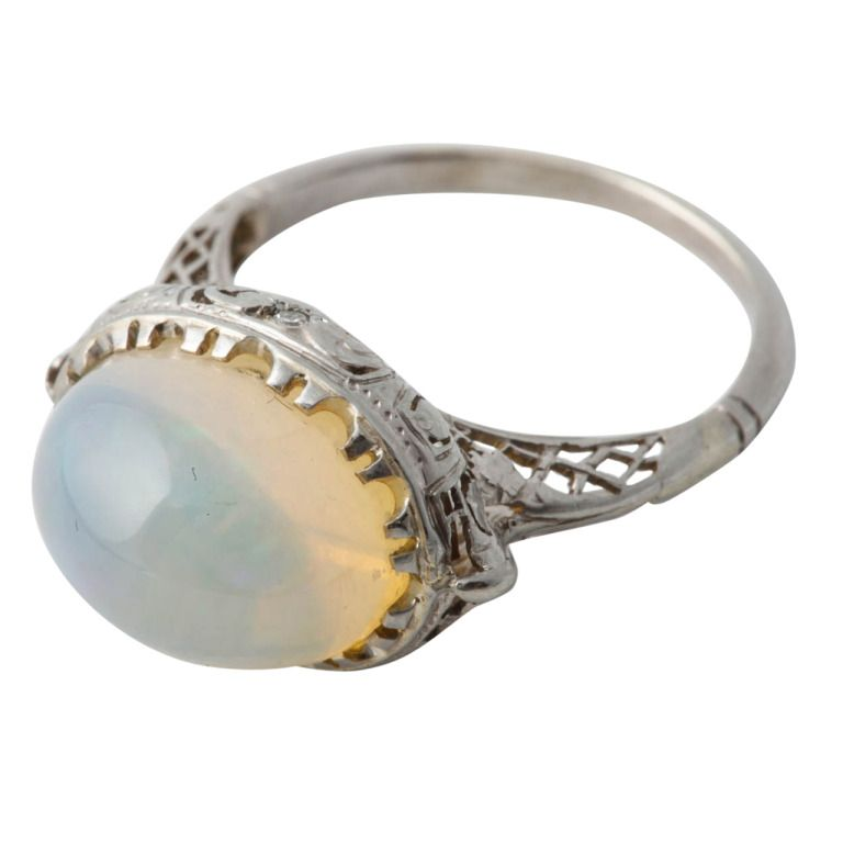 An Opal Diamond White Gold Domed Dress Ring | From a unique collection of vintage cocktail rings at http://www.1stdibs.com/jewelry/rings/cocktail-rings/