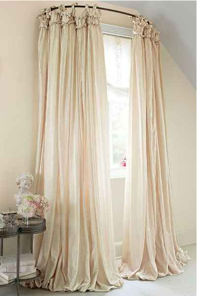 Use A Curved Shower Curtain Rod To Make A Window Look Bigger