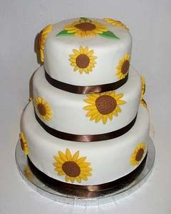 Charming three tier round wedding cake decorated with yellow