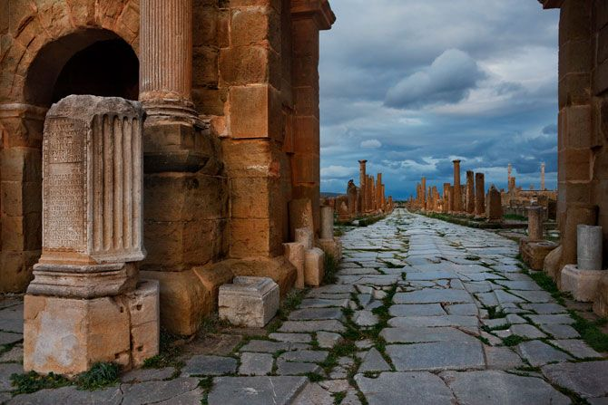 Timgad, Algeria. This triumphal arch awed visitors to the city of Thamugadi, founded by the emperor Trajan around A.D. 100 as a civilian settlement near the fort of Lambaesis. The grooves left by wagon and chariot wheels can still be seen in the stone road. Photo by George Steinmetz.