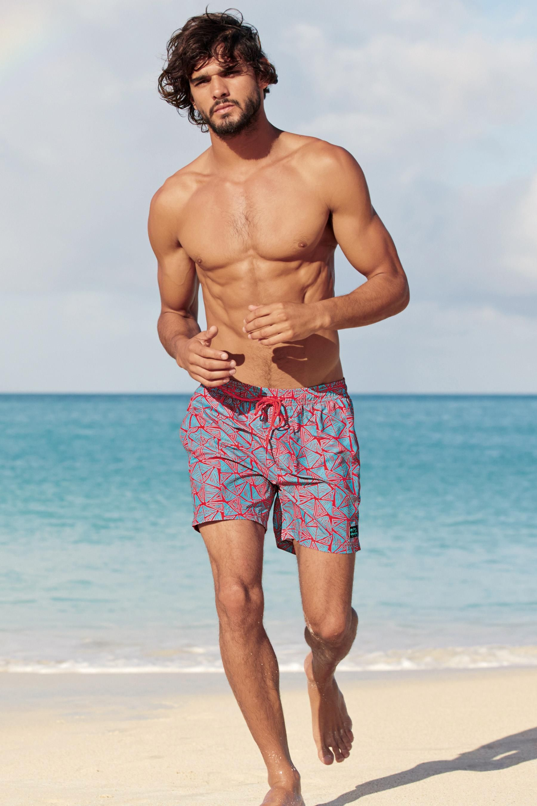 37849a7bfd88 Marlon Teixeira is back in the spotlight as he hits the beach for Next. The  Brazilian model showcases casual summer styles as he soaks in the sun.