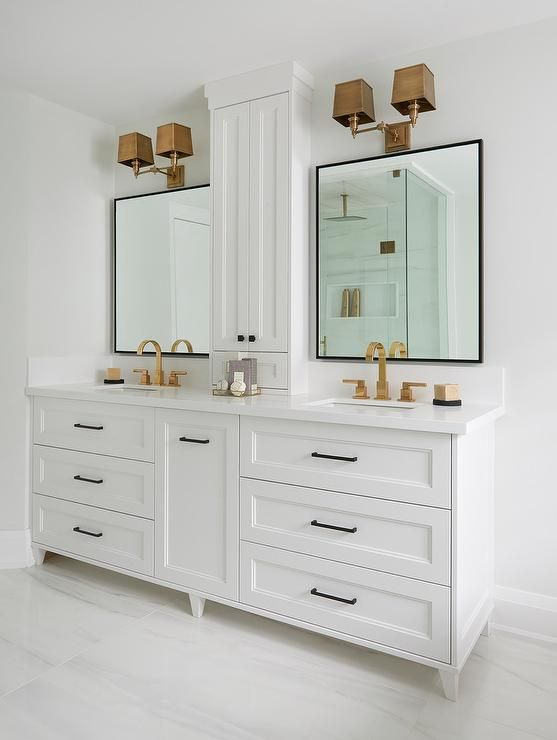 Welcoming White Bathroom Boasts A White Double Vanity Complemented With Oil Rubbed Bronze Pulls And A White Vanity Bathroom White Double Vanity Trendy Bathroom