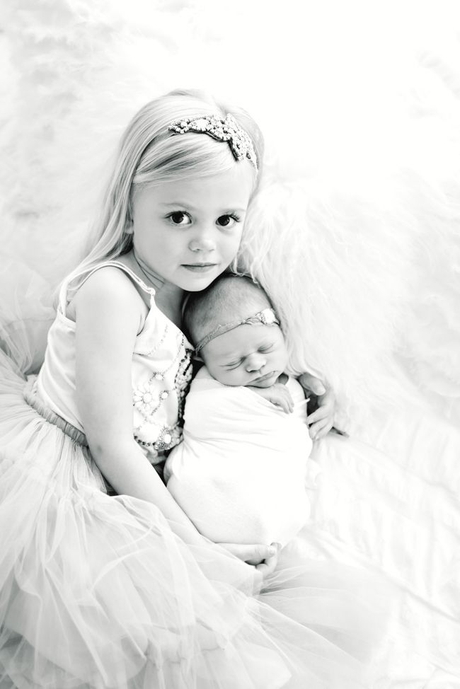 Newborn baby and big sister newborn sibling pose b couture photography