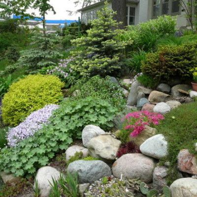 Hillside Landscaping Design For The Unexpected Beauty Actual Home In 2020 Rock Garden Design Landscaping With Rocks Sloped Garden
