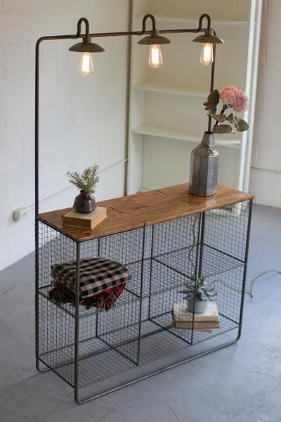 This Kalalou Wall Display with Three Lights and Six Wire Cubbies  Wood Shelf are perfect for those rooms where you need a little more storage. Place it at any corner of your house and it will store most of your items without taking much space. It's perfect for filling with favorite books, candles and vases. Produc