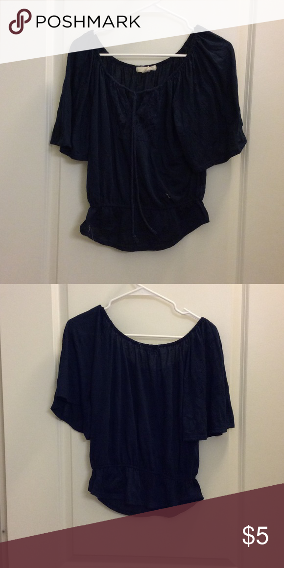 Navy blue blouse Navy blue blouse. The sleeves flare out and there's a rope to tie for the cleavage Derek Heart Tops Blouses
