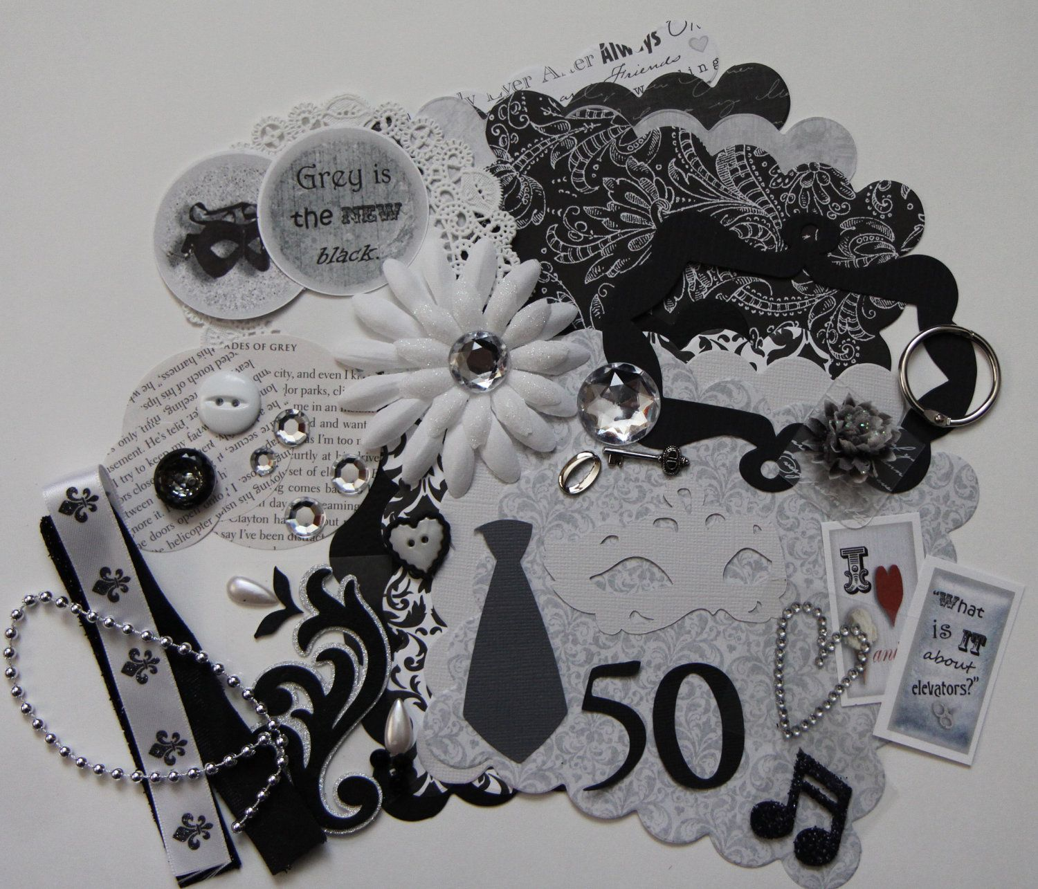 Scrapbooking Scallop Mini Book DIY Kit: Fifty Shades of Grey. $8.99, via Etsy.