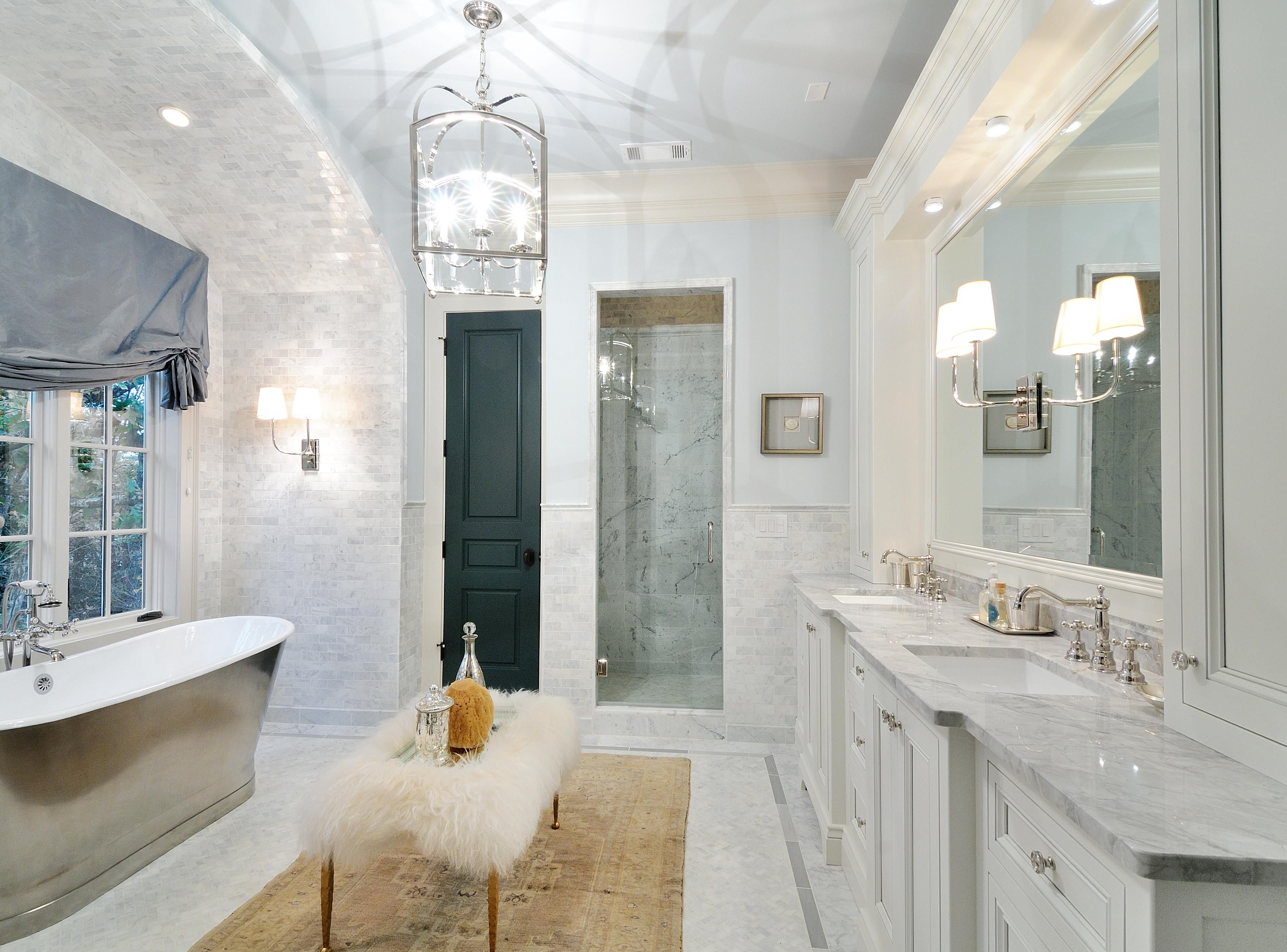 fabulous master bathroom with super white granite countertops and