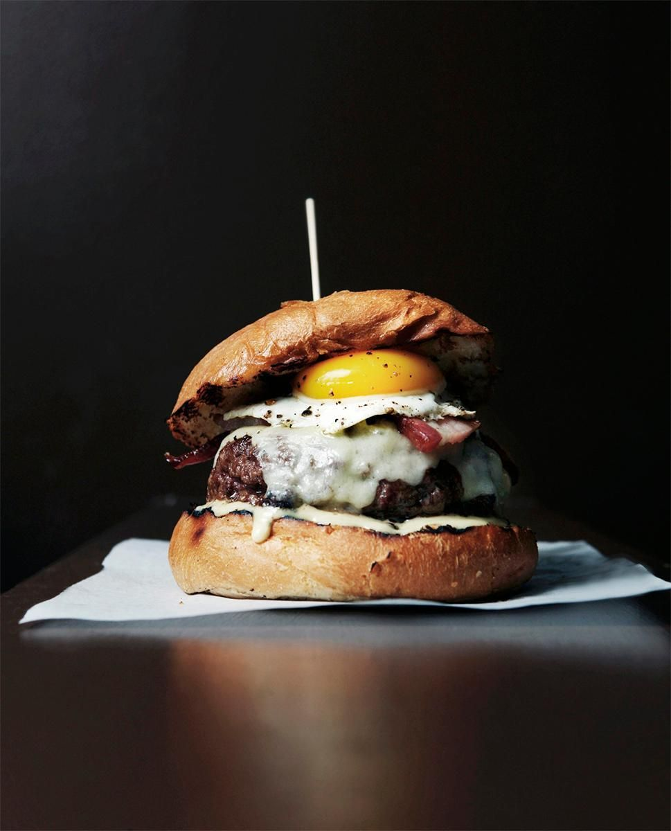 Any true burger lover knows that the simplest way to amp up your grill game is to put a fried egg on top.