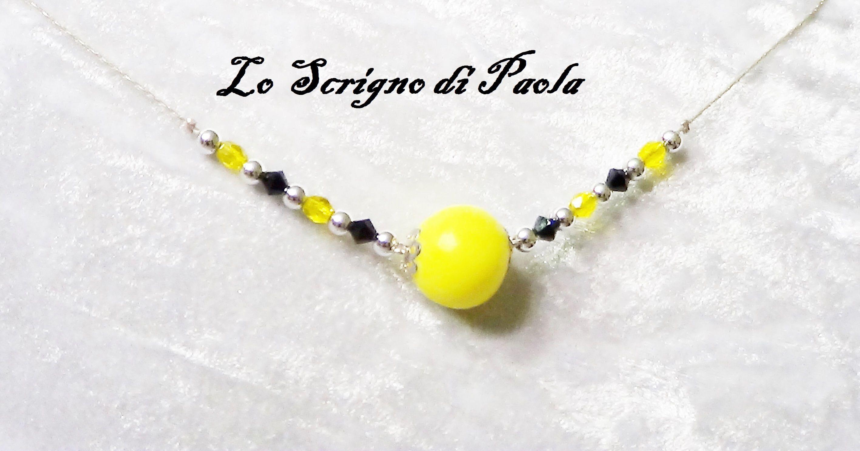 Collana con sfera in pasta di mais, realizzata a mano. Per altre creazioni potete visitare il mio blog: http://creazionibijouxpaola.altervista.org