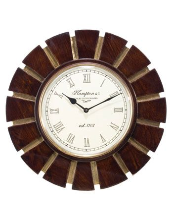 An analog timepiece symbolizing the advancement will embellish your interiors. The decorating story of the product harmonizes with texture and surface. The impressive combination of wood with brass makes it equally presentable.