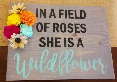 Wood sign with sola wood flowers. Sola Wood Flower Crafts