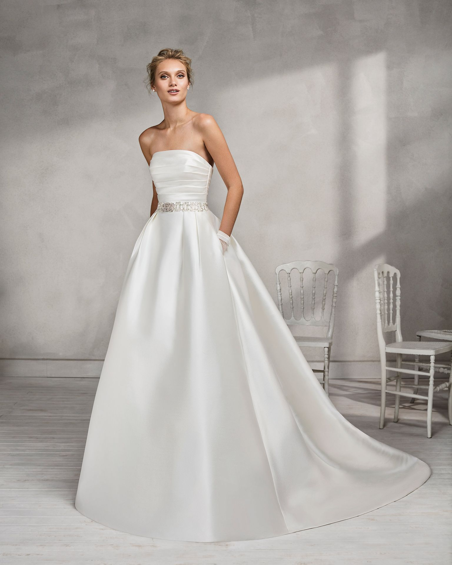 9315e7d83b3d Classic-style mikado strapless wedding dress with beaded belt. 2018 Luna  Novia Collection. Honey
