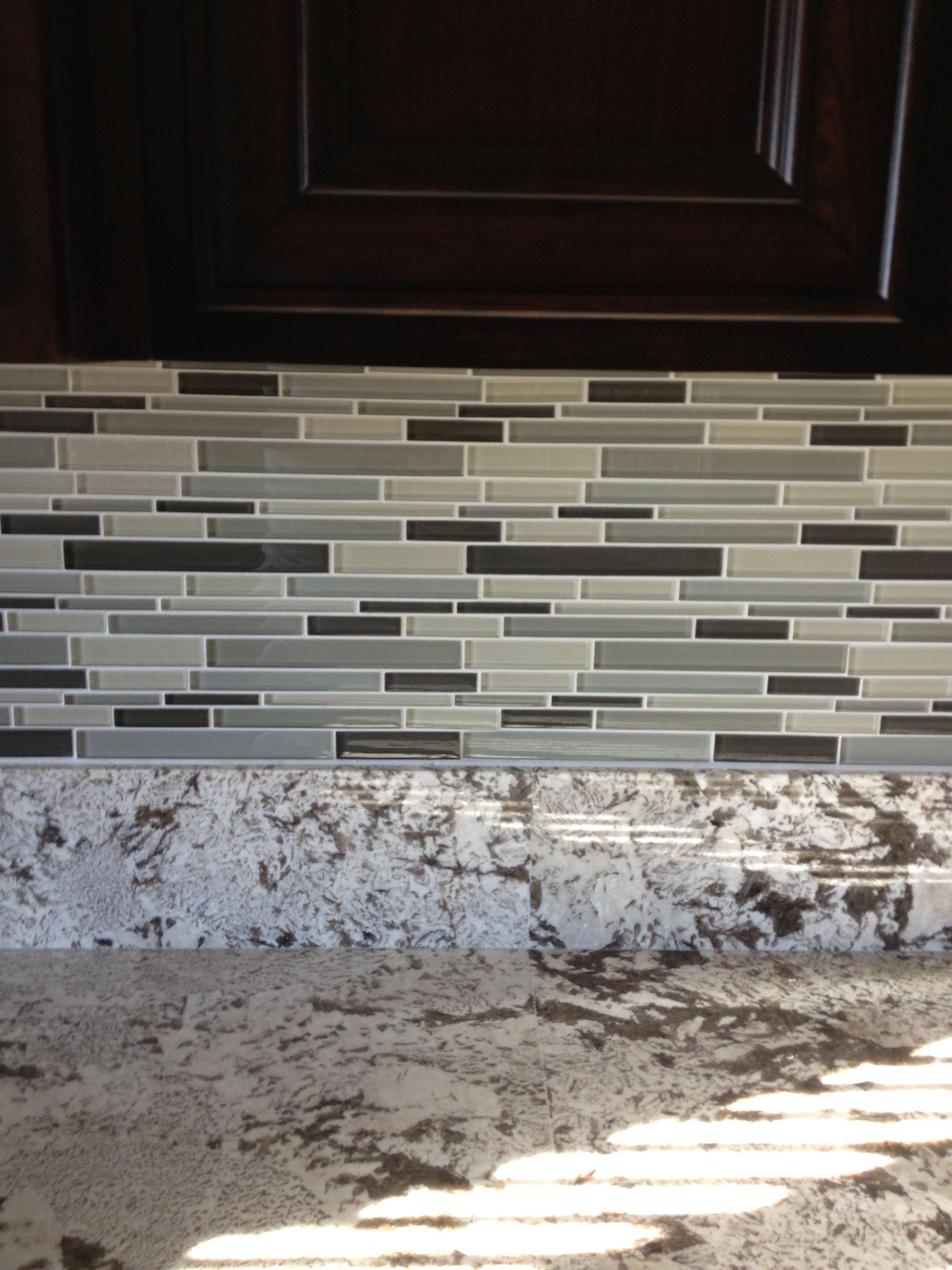 Glass tile backsplash I had installed by Lowes... Love it
