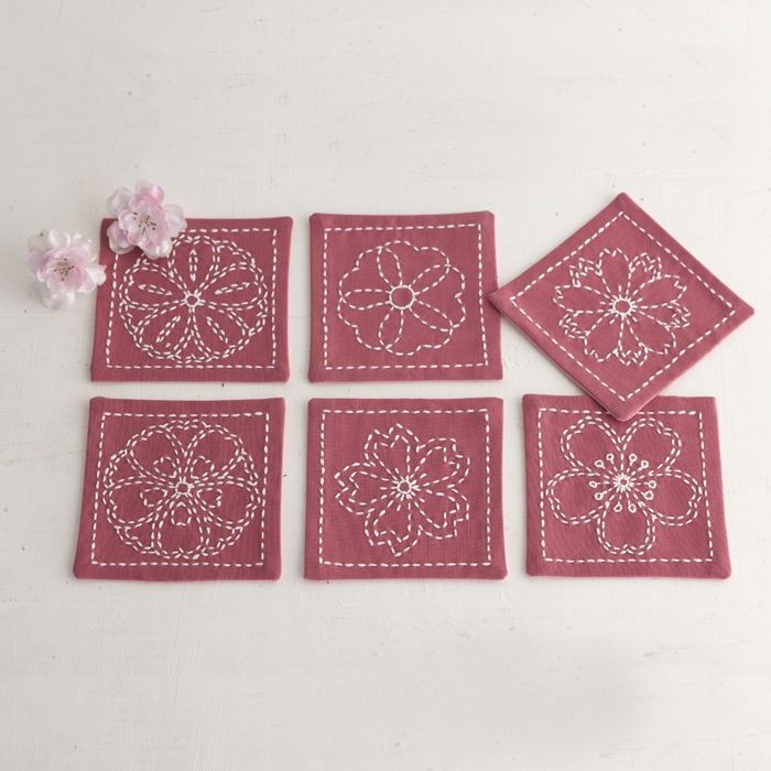 Sashiko coasters. An unusual fabric colour for sashiko, but works well with the flower motifs.