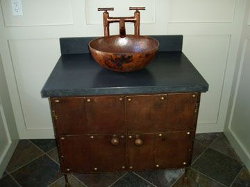 Black #concrete #vanity top, affixed with a copper vessel ...