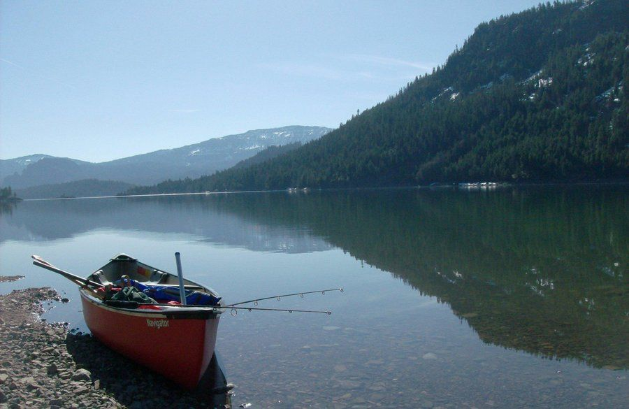 Rimrock lake with canoe in washington state by for Fishing lake washington