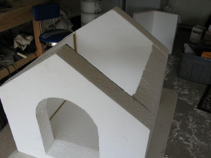 Concrete covered foam dog house i wonder if the concrete for Foam concrete house
