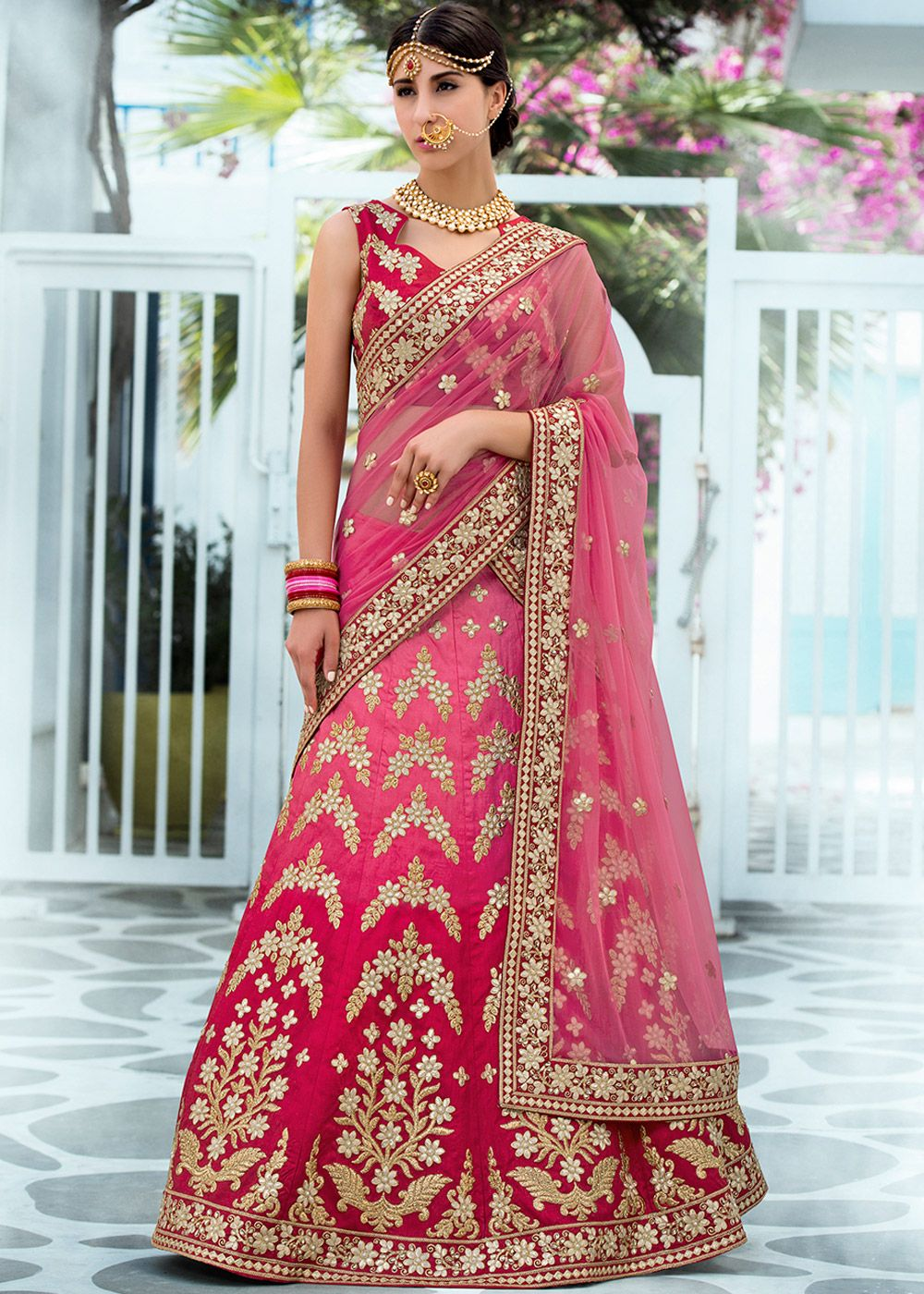 f1380b265d Pink A Line shaded silk lehenga embellished with all over gota patti work  and resham embrodiery. Accompanied by a dark pink silk choli and net  dupatta in ...