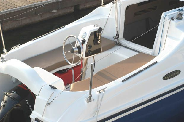 The MacGregor 26 has a pedestal mounted steering wheel