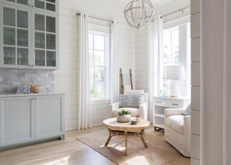 Kate Marker Interiors A Small Kitchen Sitting Area Is Furnished With White Upholstered Accent Ch Kitchen Sitting Areas Beach House Interior Beach House Decor