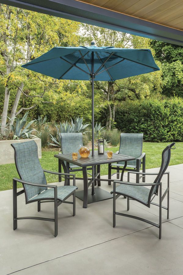 Tropitone 39 s kenzo sling dining chairs with a banchetto for Outdoor furniture spain