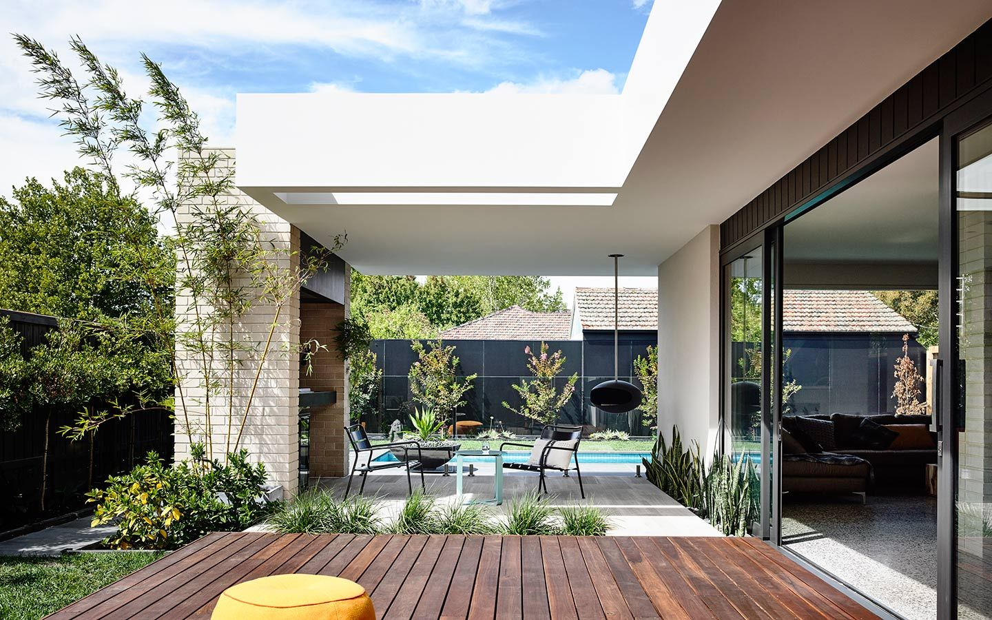 Like the decking meeting seamlessly with inside, the feature brick ...
