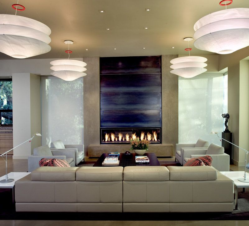 The Four Pendant Fixtures (Floatation By Ingo Maurer) Provide Both A Decorative  Element And A Source Of Ambient Light For This Living Room.