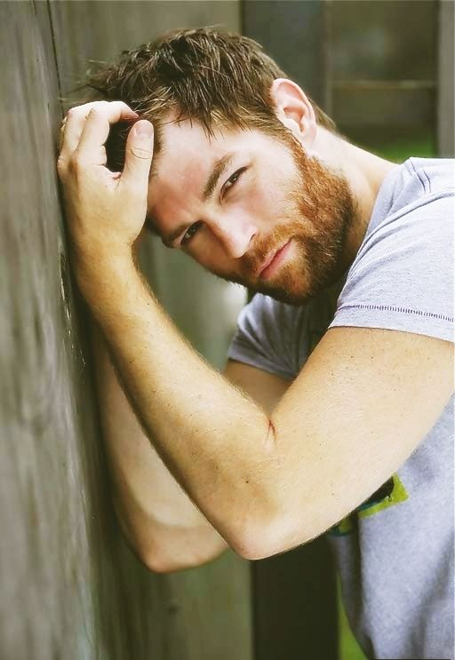 guy with beard. some emotion is happening inside of him, but i can't tell what it is because i am distracted by his hot.