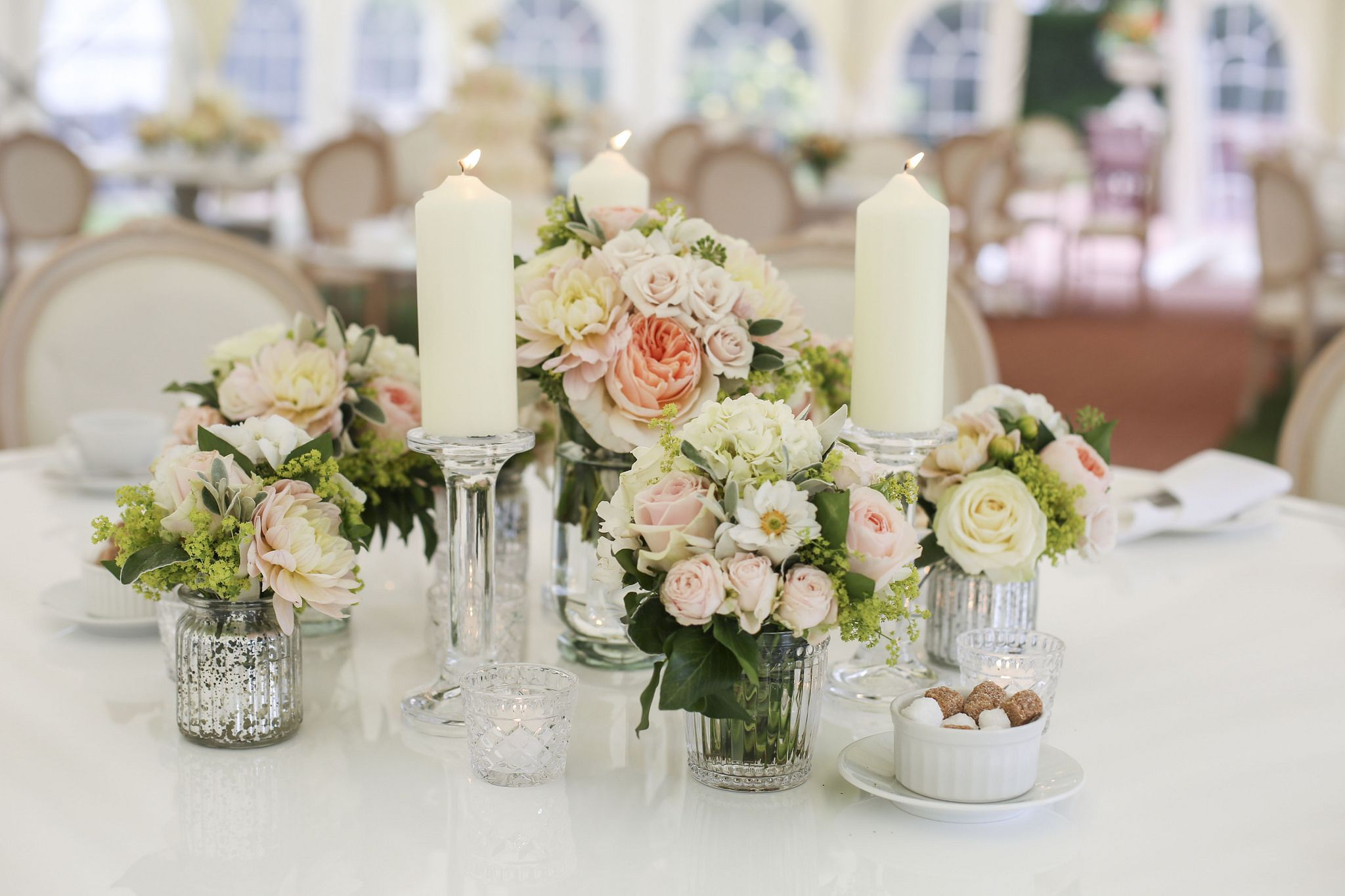 Low, Grouped, Peach And Cream Wedding Flowers With Roses, Spray