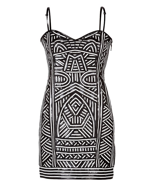Exquisitely styled with leather paneling, this strapless dress from Emilio Pucci is a directional take on tough-luxe #Stylebop