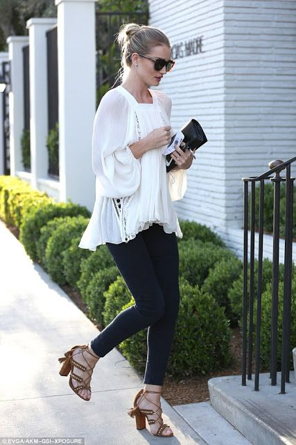 Rosie Huntington-Whiteley in a peasant blouse, black skinny pants, and chunky lace-up heels | Celebrity Street Style