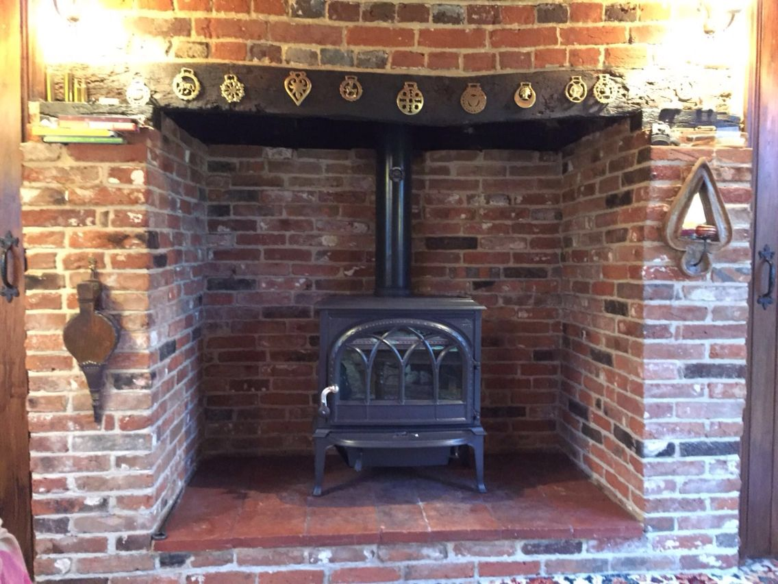 jotul f400 in blue black enamel in traditional fireplace our