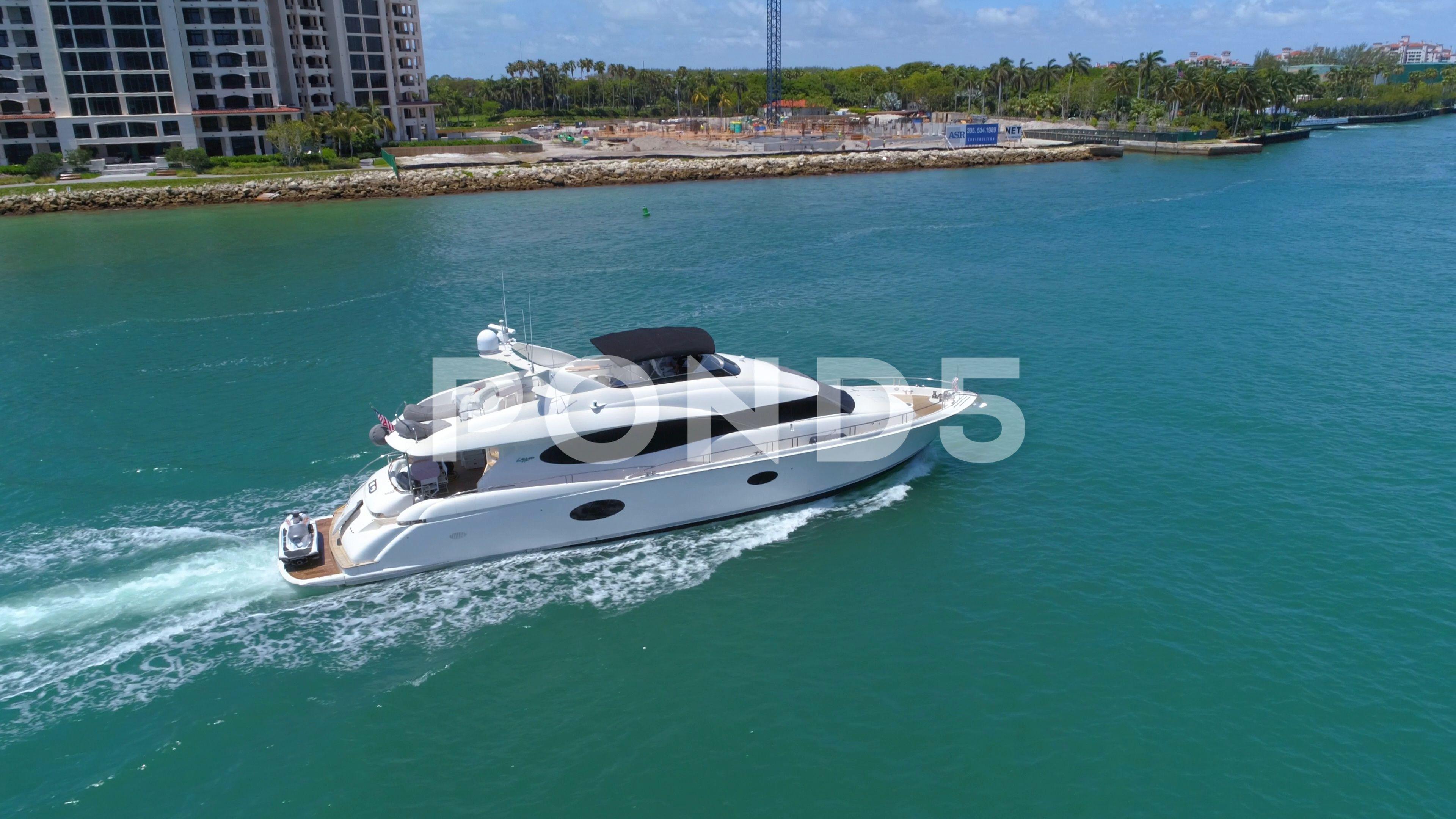 Slow Motion Drone Aerial Follow Luxury Yacht Miami Beach Stock