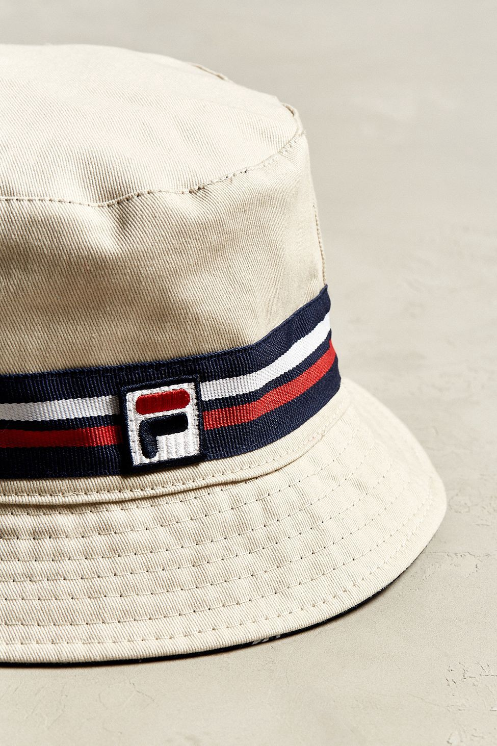 6906482109e Urban Outfitters Fila Reversible Bucket Hat - White One Size ...