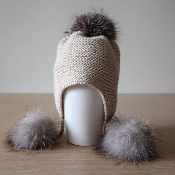 ef0d496ad2b Womans beige chunky knit hat with ear flaps and triple fox fur pom poms. Pom  poms are detachable. Hand knitted from supergeelong lambswool which can  compare ...