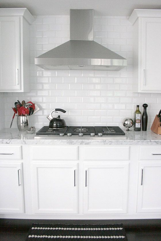small shop Erika Brechtel white kitchen carrera marble subway tile ...