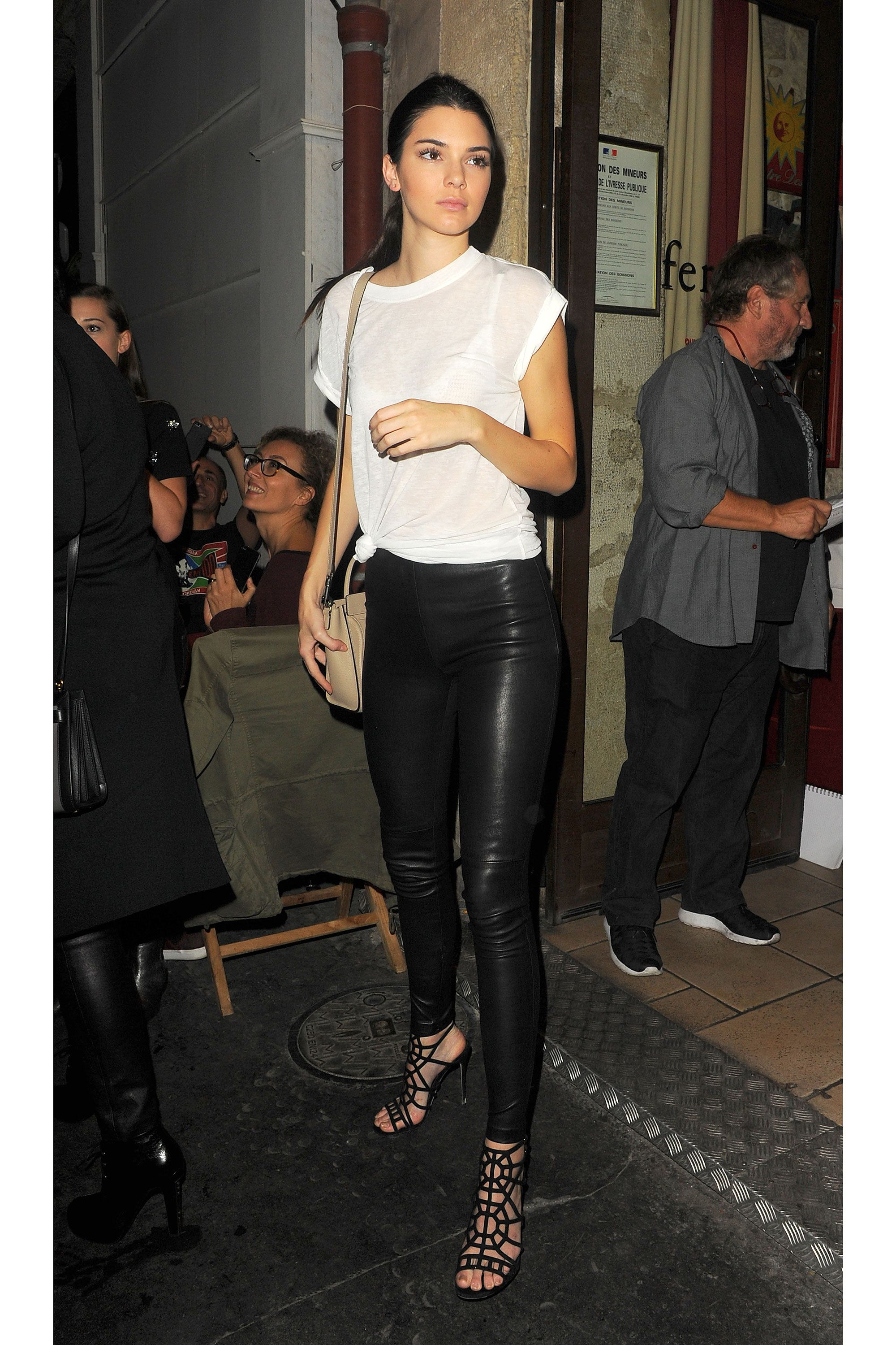 Watch Kendall Jenner wears orange turtleneck and leather pants video