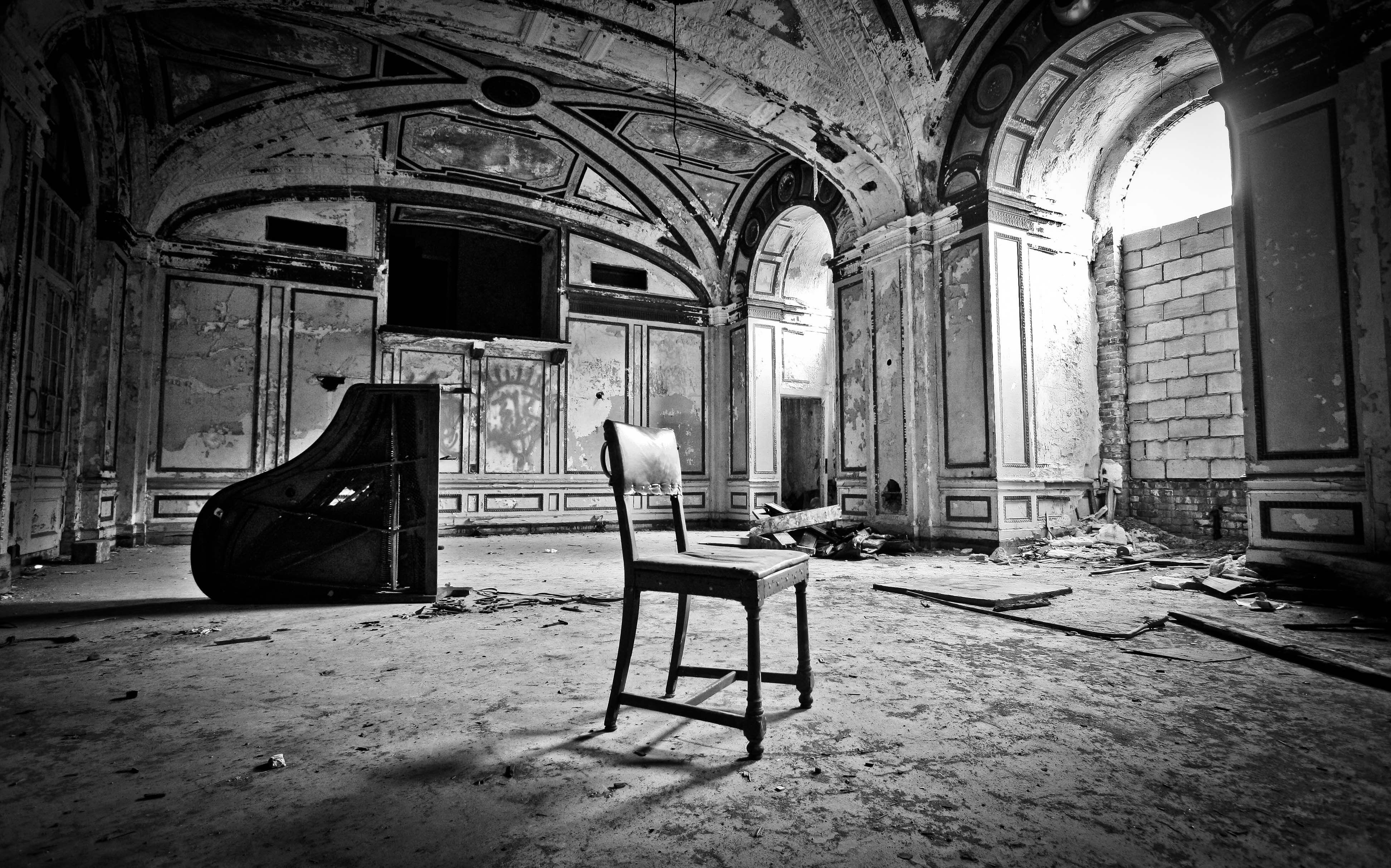 I ended up processing this image in black and white because I liked the antiquated and dramatic feel it gave this abandoned hotel lobby.