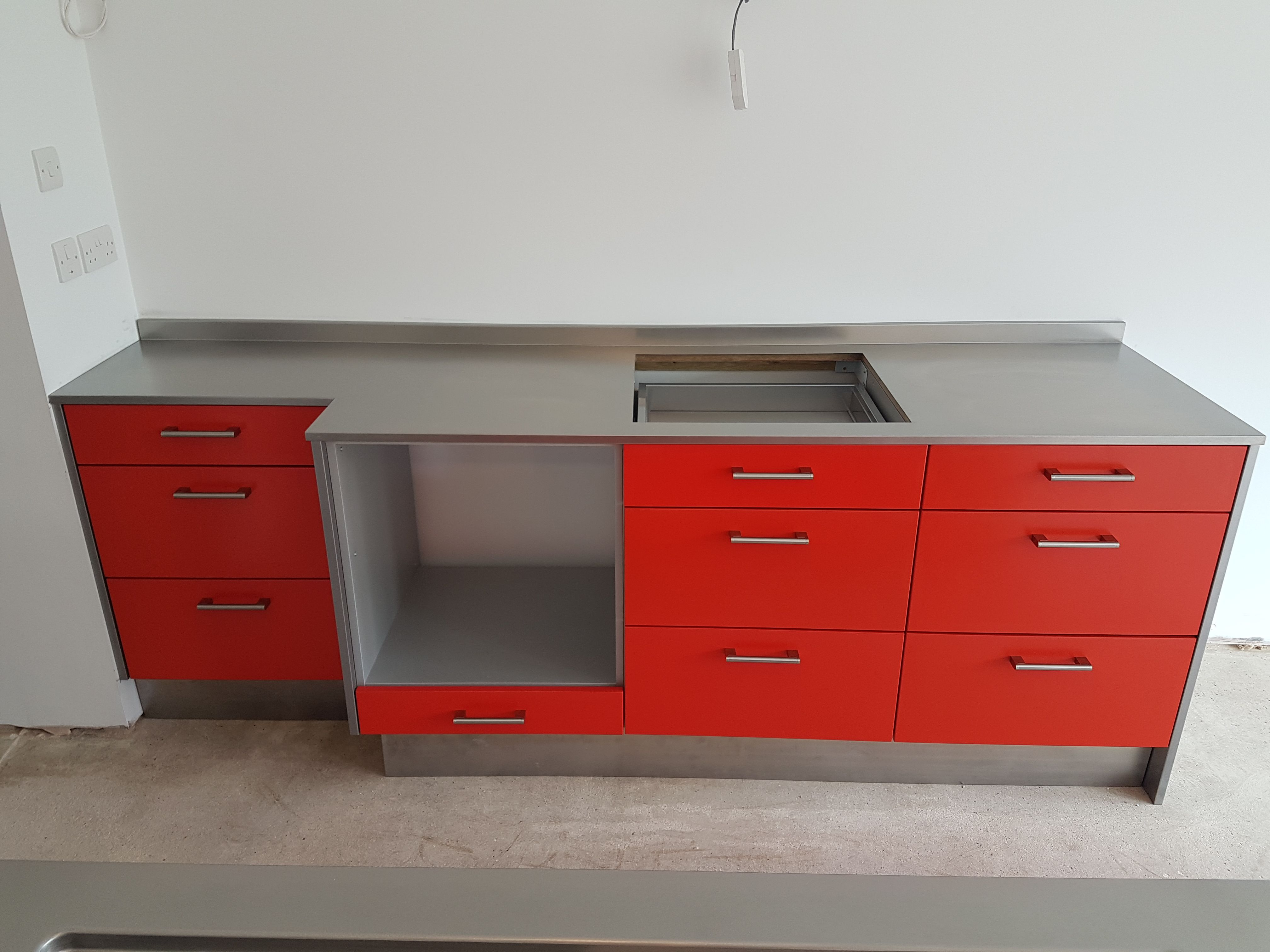 Hybrid Stainless Steel Kitchen Installation With Powder Coated Red Door And Drawer Fascia Panels 3 Stainless Steel Kitchen Kitchen Installation Red Door