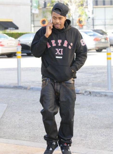 "bea61db384fef7 Nas Wearing Air Jordan IV ""Bred"" Sneakers"